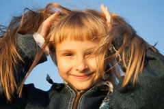 Young girl in the sunset light Stock Photography