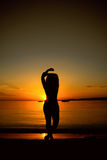 Young girl at sunset Royalty Free Stock Image