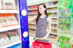 Young girl in the supermarket Stock Photo
