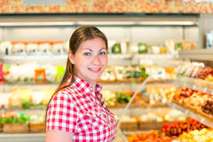 Young girl in a supermarket vegetable department Stock Photo
