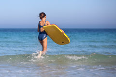 Young girl with surfboard Royalty Free Stock Photography