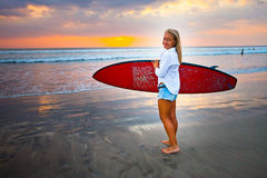 Young girl with surfboard at the beach Royalty Free Stock Photo