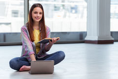 The young girl surfing internet on laptop Stock Image
