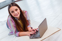 The young girl surfing internet on laptop Stock Photography