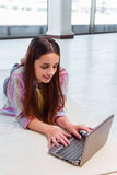 The young girl surfing internet on laptop Royalty Free Stock Photos
