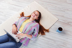 The young girl surfing internet on laptop Royalty Free Stock Image