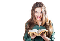 Young girl surprised, flipping through the pages of the book to isolate. Is reading. Shock. Royalty Free Stock Photography