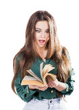 Young girl surprised, flipping through the pages of the book to isolate. Is reading. Shock. Stock Photo