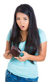 A young girl surprised at her empty wallet Royalty Free Stock Images
