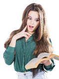 Young girl surprised, holding the book to isolate. Is reading. Young girl surprised, holding the book to isolate. Is reading Royalty Free Stock Image