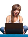 Young girl surprised with laptop Stock Images