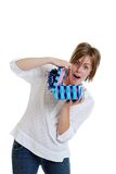 Young girl surprised with a present. Isolated Young girl surprised with a present on a white background Stock Images