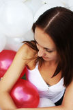 Young girl surrounded by balloons Royalty Free Stock Images
