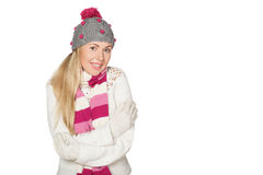 Young girl in sweater, hat, scarf and mittens. Royalty Free Stock Photography