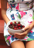 The young girl with sweet cherry Stock Image