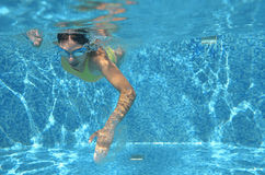 Young girl swimmer swimming freestyle in pool, under water view, sport and fitness Royalty Free Stock Photography