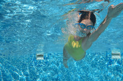 Young girl swimmer swimming freestyle in pool, under water view, sport and fitness Royalty Free Stock Images
