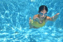 Young girl swimmer swimming under water in pool and has fun, teenager diving underwater, family vacation, sport and fitness Royalty Free Stock Photos
