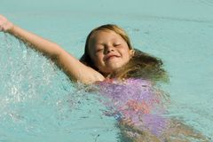 Young Girl Swimming. In pool Stock Image