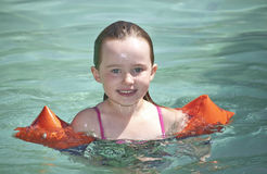 Young girl swimming Stock Photography
