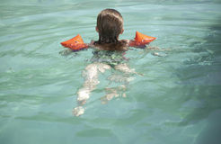 Young girl swimming Stock Photo
