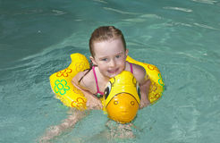 Young girl swimming Stock Images