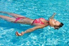 Young girl is swimming Stock Images