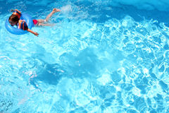 Young girl swimming Stock Photos