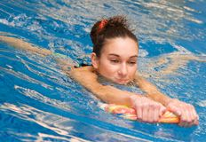 Young girl is swimming Royalty Free Stock Photos