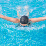 Young girl swimming butterfly stroke style Stock Images