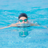 Young girl swimming butterfly stroke style Royalty Free Stock Photography