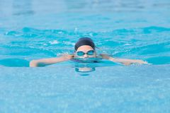 Young girl swimming butterfly stroke style Stock Image