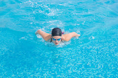Young girl swimming butterfly stroke style Stock Photo