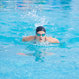Young girl swimming butterfly stroke style Stock Photos