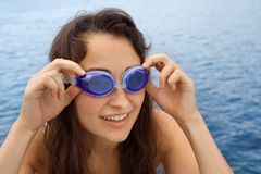 Young girl with swimming glasses Royalty Free Stock Images
