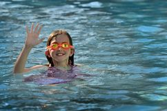 Young Girl Swimming with Goggles Stock Photography