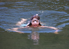 Young girl swimming with goggles and snorkel Stock Images