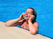 Young girl in a swimming pool. The happy young girl in a swimming pool Royalty Free Stock Photos