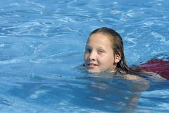 Young girl swimming in pool Stock Images