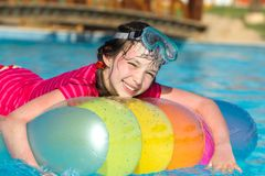 Young Girl in Swimming Pool Stock Photo
