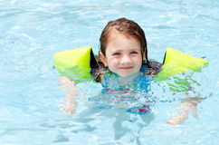 Young girl swimming in pool Royalty Free Stock Image