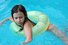 Young girl swimming in pool Stock Photos
