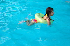 Young girl swimming in pool Stock Photography