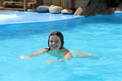 Happy Girl swimming. In a pool Royalty Free Stock Images