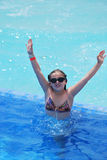Young girl in swimming pool. Young girl swimming in pool with goggles Stock Photography