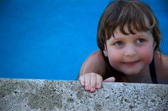 Young Girl in swimming pool. Three year old toddler girl out for a swim Stock Image