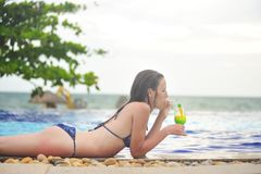 Young girl at swimming pool drinking cocktail. Phu Quoc Island. Vietnam Stock Images