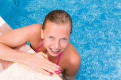 Young girl in a swimming pool. Young smiling girl in the swimming pool Stock Photos
