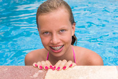 Young girl in a swimming pool. Young smiling girl in the swimming pool Royalty Free Stock Photo