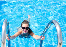 Young girl in the swimming pool Stock Image